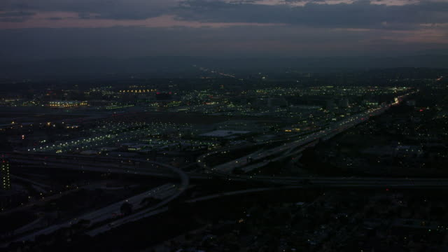 Aerial flying around LAX airport at sunrise, Los Angeles, CA