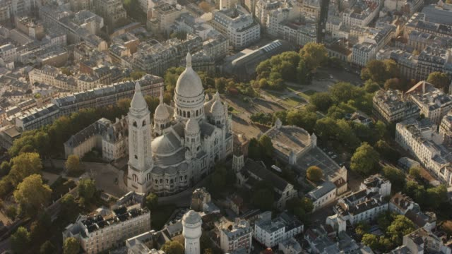 aerial flying around montmartre and the sacré-cœur in paris france, morning - basilique du sacre coeur montmartre stock videos & royalty-free footage