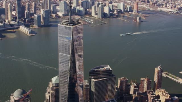 Aerial flying around One World Trade Center, daytime NYC