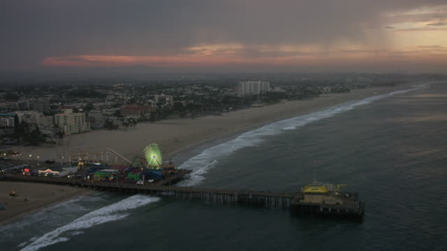 aerial flying around santa monica beach in los angeles, ca morning - venice california stock videos and b-roll footage
