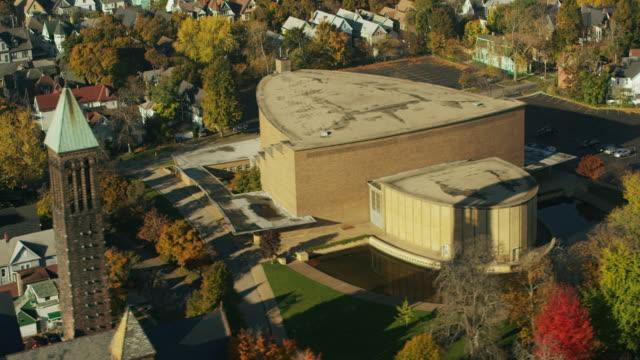 aerial flying around school and football field, buffalo ny - buffalo new york state stock videos & royalty-free footage