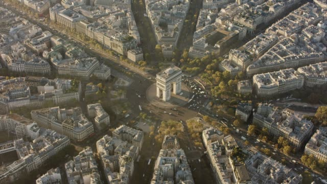 Aerial flying around the Arc de Triomphe in Paris France, morning