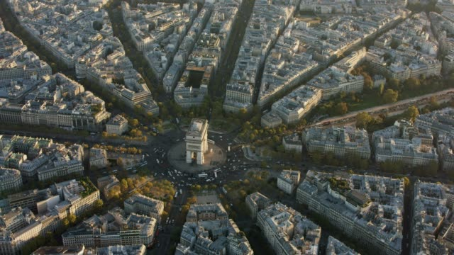aerial flying around the arc de triomphe in paris france, sunset - triumphbogen paris stock-videos und b-roll-filmmaterial