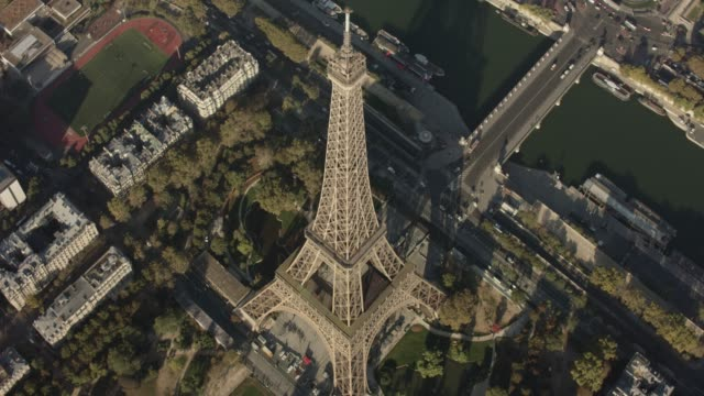 aerial flying around the eiffel tower in paris france, daytime - eiffel tower paris stock videos & royalty-free footage