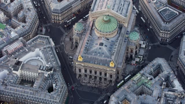 aerial flying around the opera palais garnier in paris france, sunset - opera house stock videos & royalty-free footage