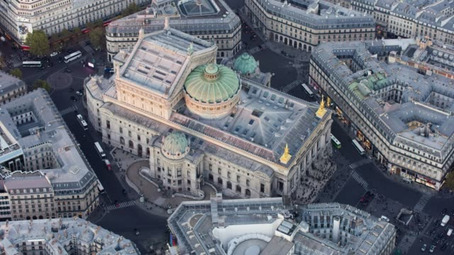 aerial flying around the opera palais garnier in paris france, sunset - オペラ座点の映像素材/bロール