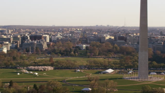 Aerial flying around The White House past the Washington Monument DC