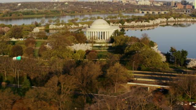 Aerial flying around Thomas Jefferson Memorial at sunrise Washington DC