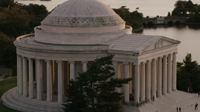 aerial flying around thomas jefferson memorial sunset washington dc - jefferson memorial stock videos & royalty-free footage
