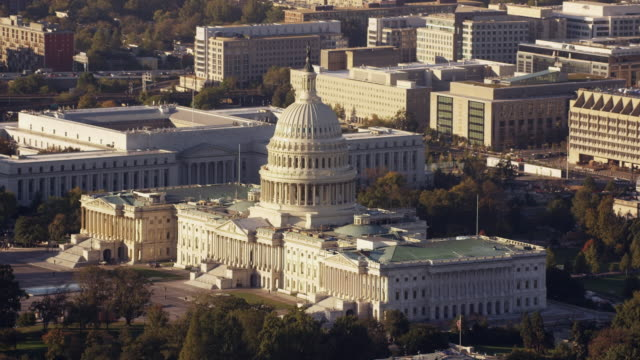 Aerial flying around United States Capitol, afternoon Washington DC