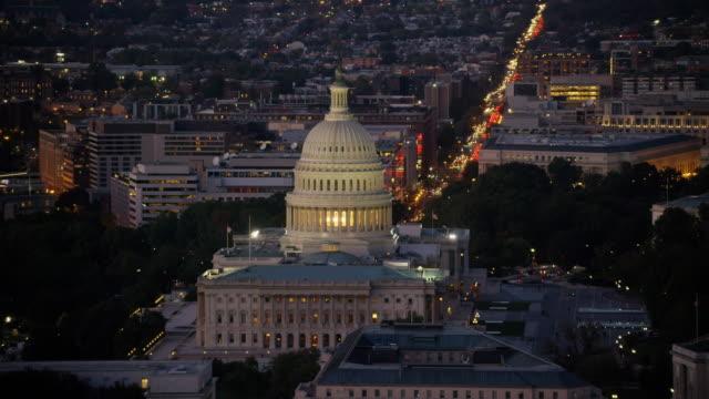 Aerial flying around United States Capitol, evening Washington DC