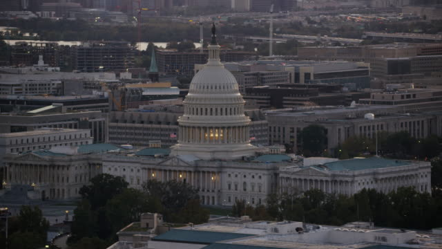 aerial flying around united states capitol, sunset washington dc - ronald reagan washington national airport stock videos and b-roll footage
