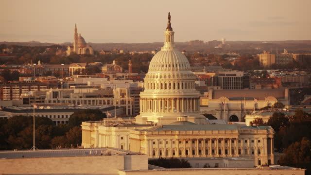 Aerial flying around United States Capitol, sunset Washington DC