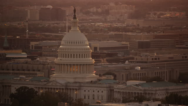 aerial flying around united states capitol, sunset washington dc - the pentagon stock videos and b-roll footage