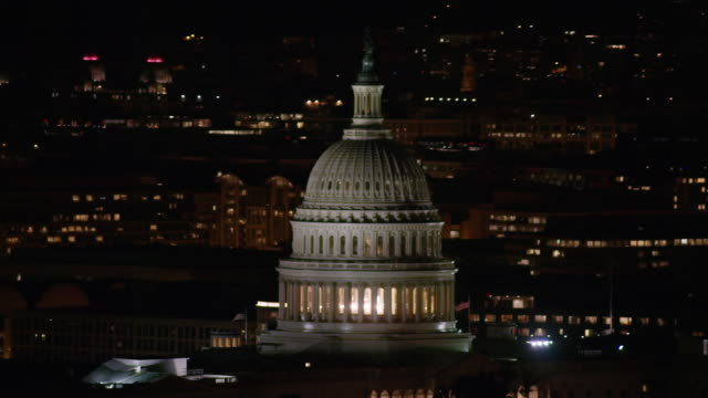 aerial flying around united states capitol, washington dc night - capitol building washington dc stock videos & royalty-free footage