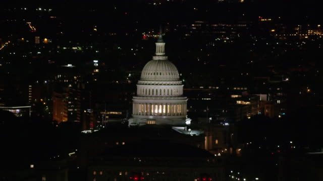 Aerial flying around United States Capitol, Washington D.C. Night