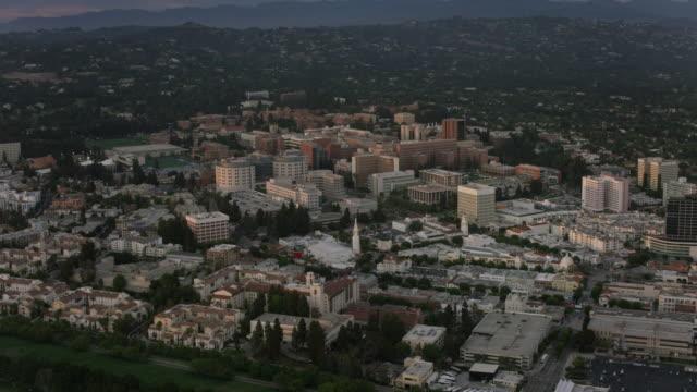 aerial flying around university of california los angeles, sunset - university of california bildbanksvideor och videomaterial från bakom kulisserna