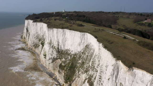 aerial flying back along the white cliffs of dover, daytime - cliff stock videos & royalty-free footage
