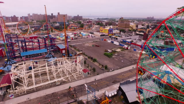 aerial flying back over coney island, beach and atlantic ocean in brooklyn, new york city - coney island brooklyn stock videos & royalty-free footage