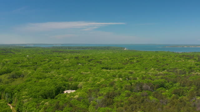 aerial flying back over water mill ny away from peconic bay, daytime - insel long island stock-videos und b-roll-filmmaterial
