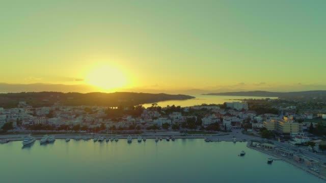 Aerial - flying backwards above a small harbor at dusk - Porto Heli - Porto Cheli - Greece - Argolis - Argolida