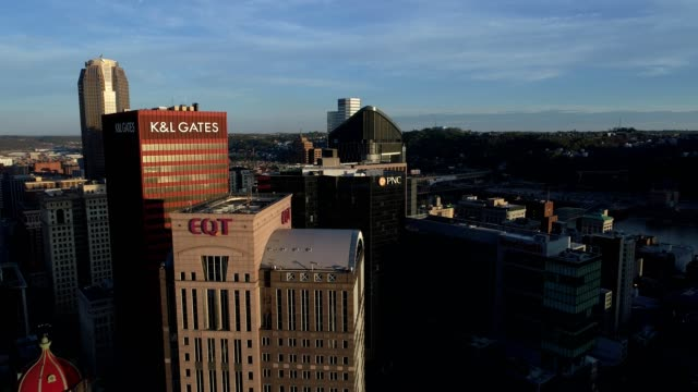 aerial flying by k&l gates and eqt building in pittsburgh during sunset! - pittsburgh video stock e b–roll