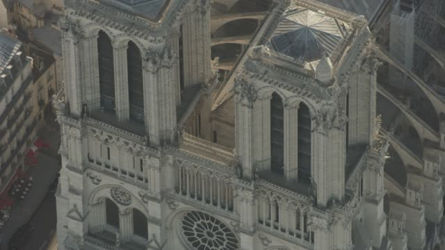 aerial flying close over the cathédrale notre-dame, in paris france daytime - cathedral stock videos & royalty-free footage
