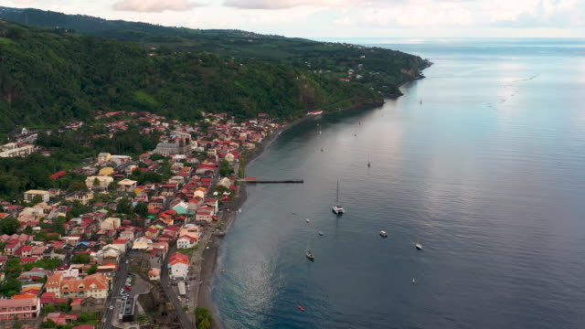 stockvideo's en b-roll-footage met aerial flying high over caribbean town of saint-pierre in martinique, daytime - french overseas territory