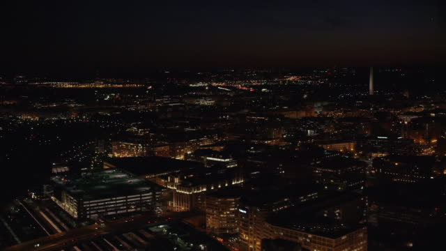 aerial flying high over washington d.c. at night - washington monument washington dc stock videos & royalty-free footage