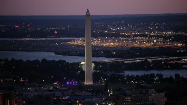 Aerial flying high over Washington D.C., Washington Monument, sunset DC