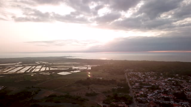aerial flying high up over the salt marshes ile de re, france at sunrise - france stock videos & royalty-free footage