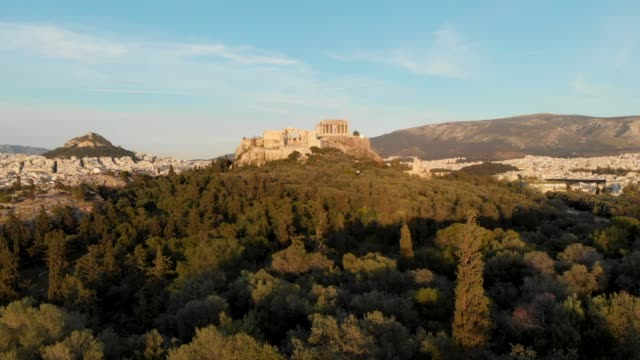 Aerial - flying into the Acropolis of Athens through a hill