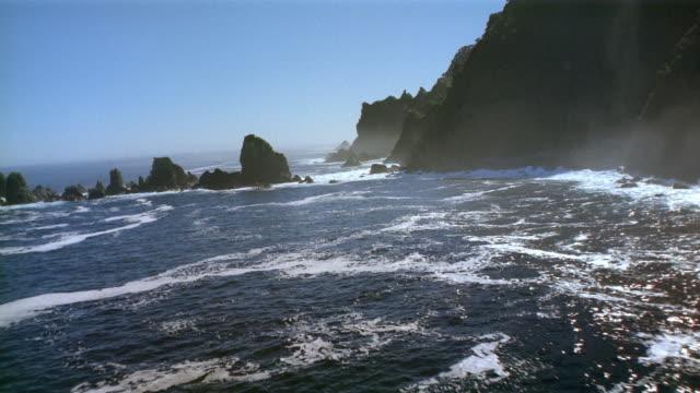 aerial flying low along cliffs on coastline / new zealand - rocky coastline stock videos & royalty-free footage