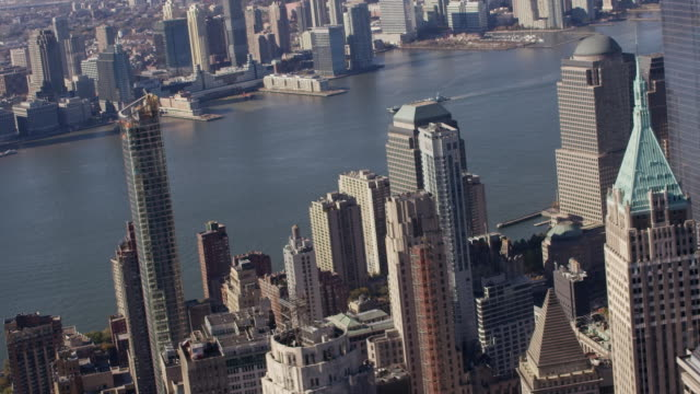 Aerial flying low over buildings in downtown Manhattan, NYC