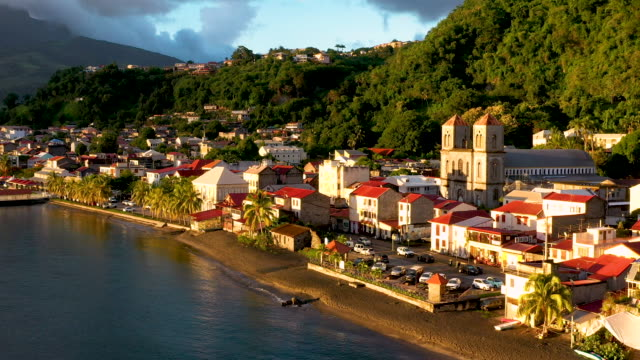 aerial flying low over caribbean town of saint-pierre in martinique, sunset - french overseas territory stock videos & royalty-free footage