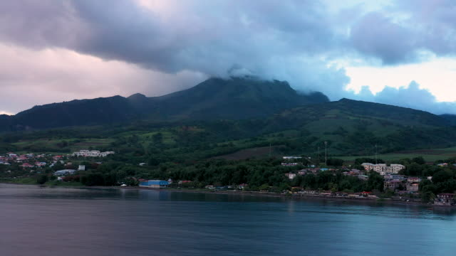 aerial flying low over caribbean town of saint-pierre towards mount pelée in martinique, daytime - french overseas territory stock videos & royalty-free footage