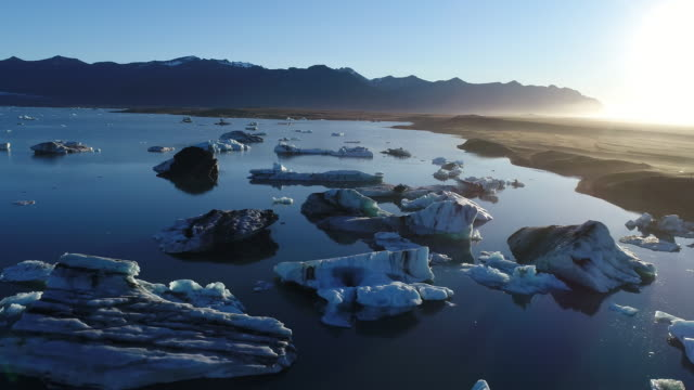 Aerial flying low over Jokulsarlon glacier lagoon in Iceland