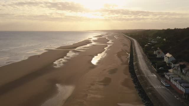 aerial flying low over omaha beach in france at sunrise - normandy stock videos & royalty-free footage