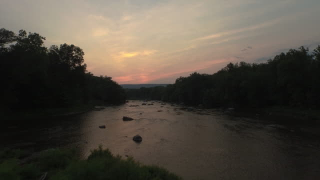 aerial flying low over river then up over trees at sunset - new paltz stock videos and b-roll footage