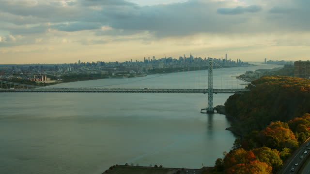 Aerial flying next to Hudson River over Palisades parkway, NYC skyline in distance