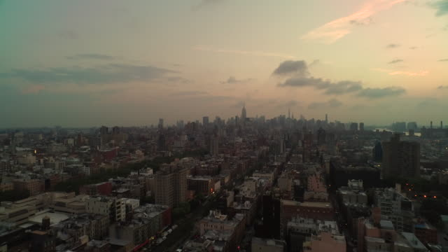 aerial flying north and panning west low over buildings at sunrise in manhattan nyc - aircraft point of view stock videos & royalty-free footage
