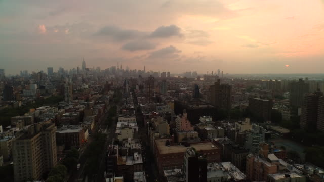 aerial flying north from lower east side at sunrise in manhattan nyc - brooklyn new york stock videos & royalty-free footage