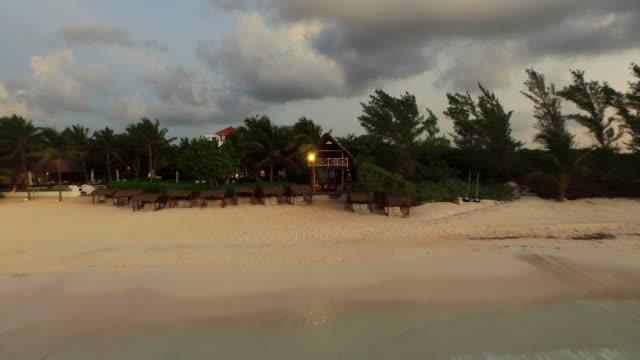 vídeos y material grabado en eventos de stock de aerial flying out over the ocean from beach and coastline - playa del carmen