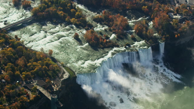 aerial flying over american falls, niagara river, daytime - niagara falls stock videos and b-roll footage