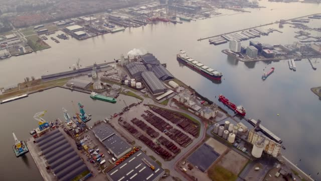 Aerial flying over Amsterdam industrial and shipping area