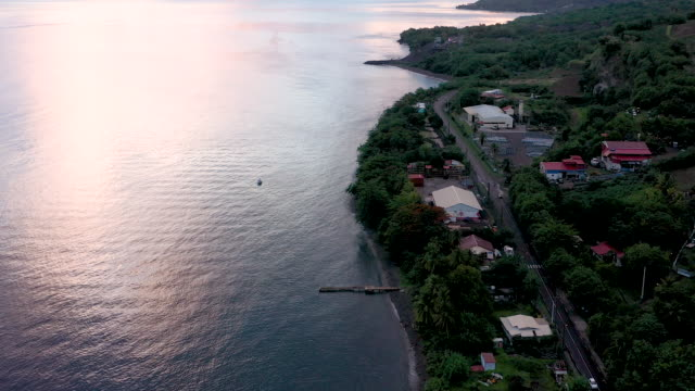 aerial flying over and following road outside caribbean town of saint-pierre in martinique, daytime - french overseas territory stock videos & royalty-free footage
