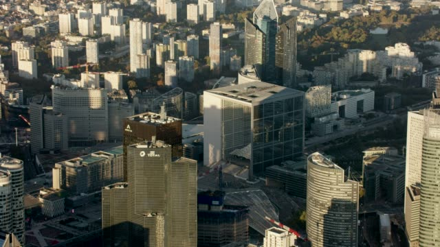 Aerial flying over and looking at La Defense in Paris France, morning