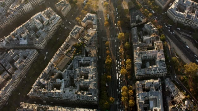 aerial flying over and looking at the arc de triomphe in paris france, morning - place charles de gaulle paris stock videos & royalty-free footage