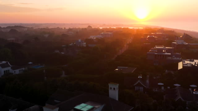 aerial flying over beach and houses, bridgehampton, ny at sunrise - bridgehampton stock videos & royalty-free footage
