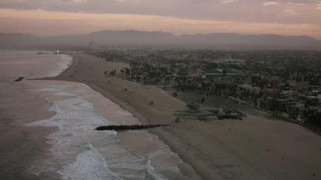 aerial flying over beach in los angeles, ca morning - malibu beach stock videos & royalty-free footage